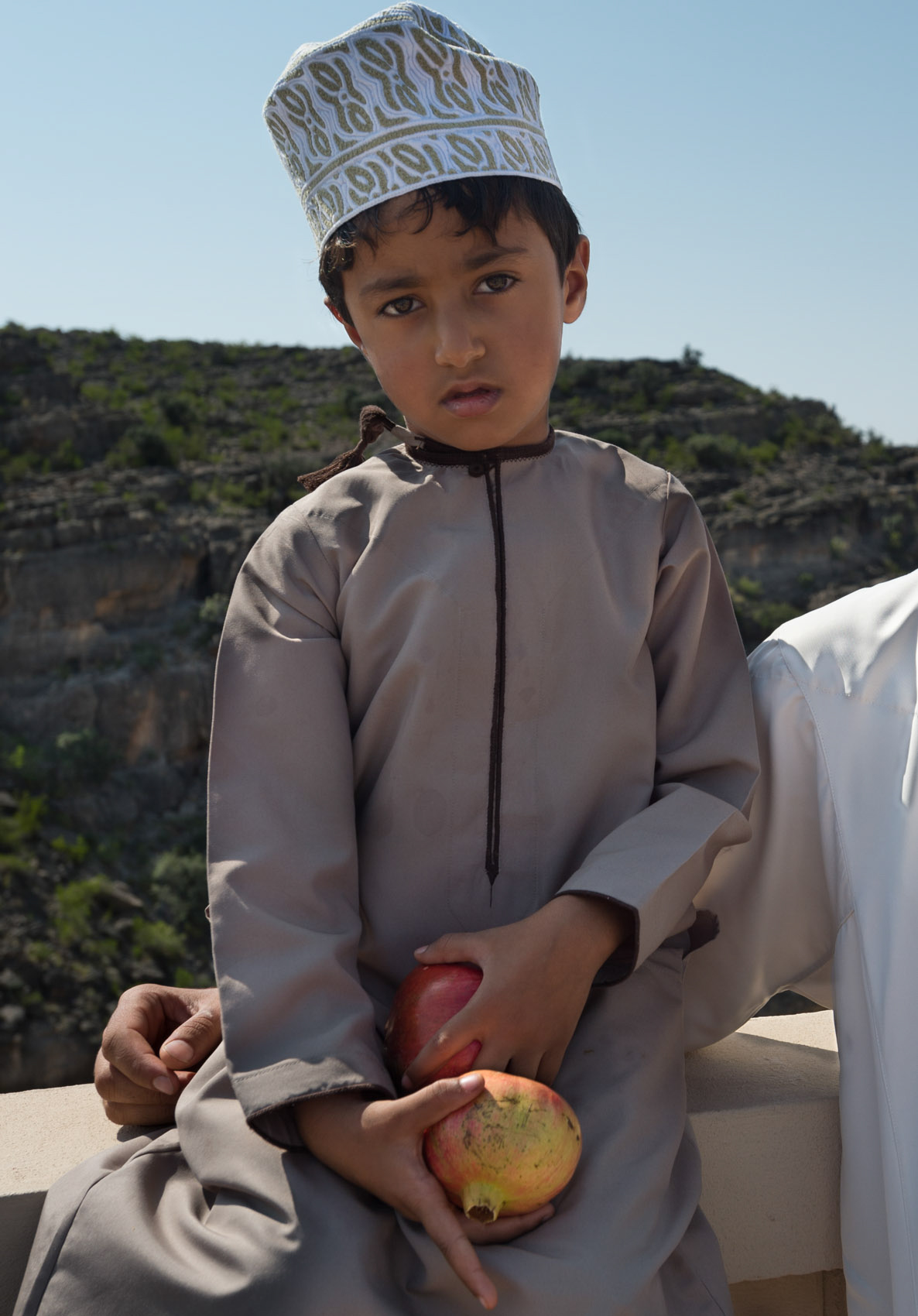 portrait-590 Omani boy with pomegranate